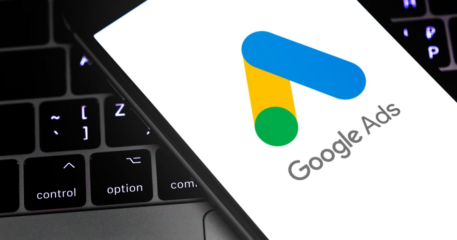 mobile phone displaying Google ads on a keyboard